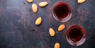 Almond liquor amaretto on a grunge black table Royalty Free Stock Photography