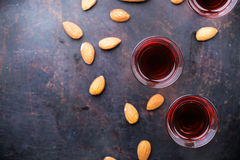 Almond liquor amaretto on a grunge black table Royalty Free Stock Image