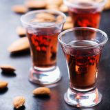 Almond liquor amaretto on a grunge black table Royalty Free Stock Photos
