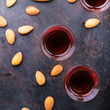 Almond liquor amaretto on a grunge black table Stock Photography