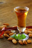 Almond liquor amaretto with nuts. Almond liquor amaretto with whole nuts Stock Images