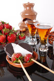 Almond liquor and fondue fountain Royalty Free Stock Photos