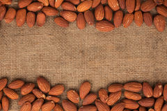 Almond lying on burlap Stock Photo