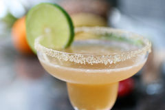 Almond Margarita cocktail with lime. Almond Margarita with lime. Shot with shallow focus Stock Photos