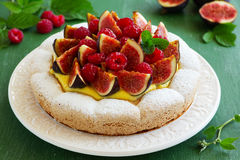 Almond meringue cake with figs. And raspberries Royalty Free Stock Photos