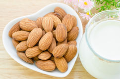 Almond milk with almond on a white bowl cup. Royalty Free Stock Photography