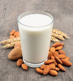 Almond milk. With almond on a wooden table Royalty Free Stock Photography