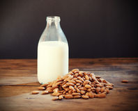 Almond milk. In bottle with almonds Stock Photos