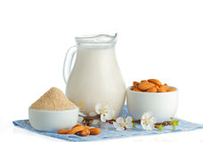 Almond milk. With almond flour and nuts on white Stock Photography