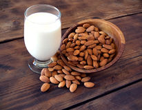 Almond milk. In glass with almonds Stock Images