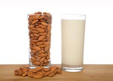 Almond milk in a glass with almonds in a glass stock image