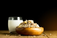 Almond milk in glass with almonds in wooden bowl on black backgr Royalty Free Stock Photography