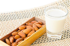 Almond milk in glass with almonds Stock Photography
