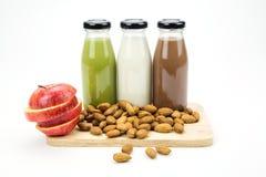 Almond milk in glass bottles Royalty Free Stock Photos