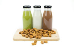 Almond milk in glass bottles  with almonds. Isolated over white Stock Image