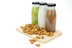 Almond milk in glass bottles  with almonds Stock Photos