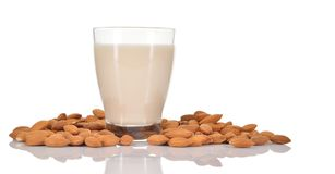 Almond milk in a glass on white background. Royalty Free Stock Images