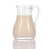 Almond milk in jug on white background. Royalty Free Stock Photos