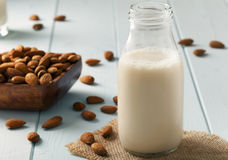Almond Milk and nuts in a wooden bowl Royalty Free Stock Photos
