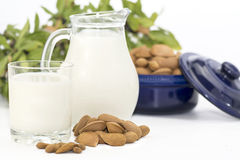 Almond milk. Organic almond milk, selective view showing almond milk in a Jug and glass with some out of focus background Royalty Free Stock Photography