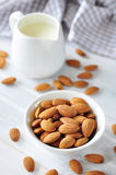 Almond. Milk with  on a wooden table Stock Photo