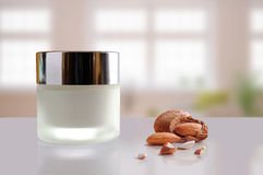 Almond moisturizer cream jar closed windows background Royalty Free Stock Images