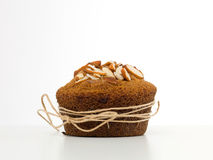 Almond muffin wrapped with a string Stock Photos