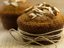 Almond muffin wrapped up as a gift Stock Photos