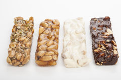 Almond nougat and honey and chocolate turron bars Stock Photos