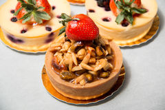 Almond nut tart on top fresh strawberry and blueberry cheese Stock Image