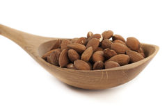 Almond Nuts. Pile of Almond Nuts on a Wooden Spoon Isolated on White Royalty Free Stock Photos