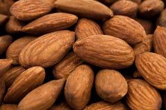 Almond nuts in abundance - closeup studio shot Stock Images