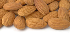 Almond nuts background. Background with almond nuts. Copy space for your own text Royalty Free Stock Images