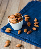 Almond nuts on blue cloth Stock Images