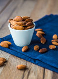 Almond nuts on blue cloth Stock Photo