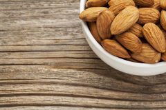 Almond nuts in a bowl Stock Images