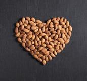 Almond nuts in heart shape Stock Photo