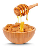 Almond nuts and honey Royalty Free Stock Photos