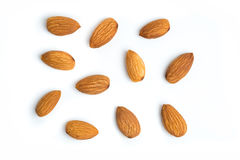 Almond nuts on isolated white background. Group of organic almond nuts with isolated white background Stock Photo