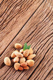 Almond nuts with leaves. Royalty Free Stock Image