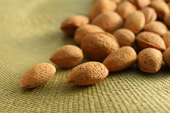 Almond nuts on natural mat Royalty Free Stock Images