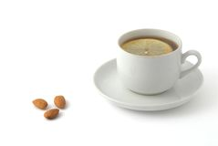 Almond nuts and tea with lemon. On the background Royalty Free Stock Photography