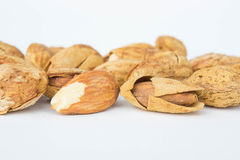 Almond nuts to stay healthy for the body. almond on white backgr Stock Photography