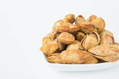 Almond nuts to stay healthy for the body. almond on white backgr Stock Image