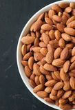 Almond nuts in white bowl.  Royalty Free Stock Photo