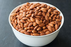 Almond nuts in white bowl.  Royalty Free Stock Image