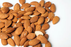 Almond nuts on white Stock Images