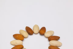 Almond nuts on the white table Royalty Free Stock Photo