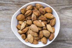 Almond nuts on wood background. Almond nuts on wood table background Royalty Free Stock Photos