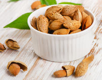 Almond nuts on wooden table Royalty Free Stock Photography